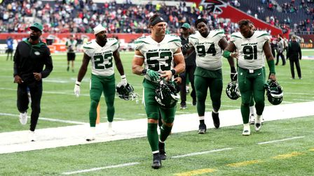 New York Jets' Blake Cashman leaves the Tottenham pitch after their NFL London game defeat