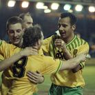 Ian Crook and Dale Gordon, right, congratulate Robert Fleck on scoring as Manchester United are beat