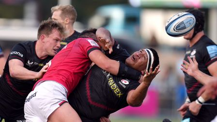 Saracens Mako Vunipola loses the ball as he is tackled by Newcastle Falcons Sean Robinson during the