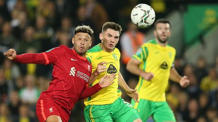 Billy Gilmour of Norwich and Alex Oxlade-Chamberlain of Liverpool in action during the Carabao Cup m