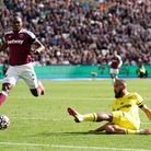 Brentford's Bryan Mbeumo scores their side's first goal of the game during the Premier League match