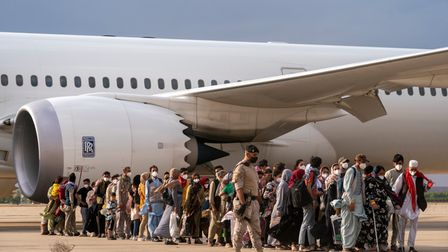 Afghan refugees disembark at the Torrejon military base as part of the evacuation process in Madrid.