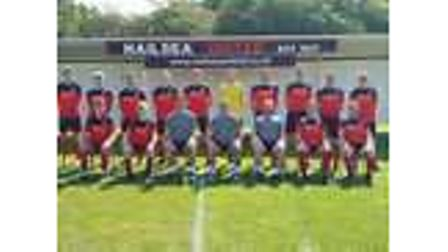 All smiles for Nailsea United as they pose for the camera.