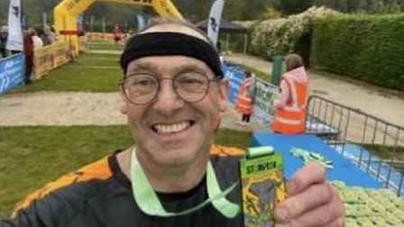 David Heal of Garden City Runners with his medal from the Colchester Zoo Stampede.