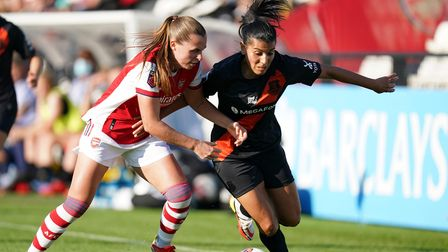 Arsenal's Noelle Maritz (left) and Everton's Kenza Dali battle for the ball during the FA Women's Su