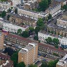 An aerial view of terraced housing and blocks of flats in London