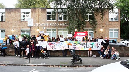 Campaigners, parents and students assemble outside Fernbank Children's Centre in Hackney.