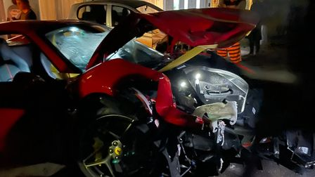 A damaged redFerrari, which was involved in the collision on Roman Road this morning.