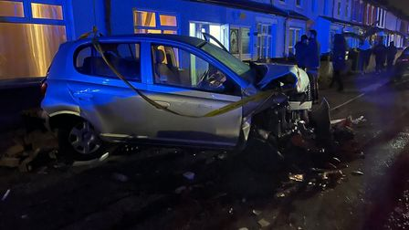 The crash caused damage to six cars, the walls of some houses, and a lamppost