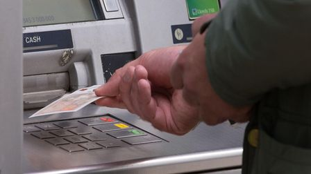 File photo dated 14/09/17 of a man withdrawing money from an ATM. Thousands of cash machines were pu