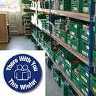 The campaign logo with the words There With You This Winter and a picture of shelves with food at Uttlesford Foodbank