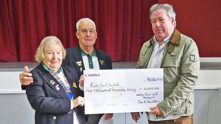 Marldon Bowls Clubpresidents June and John Gibbons presenta cheque for £2,000 to Terry Grant, on behalf of Torbay Hospital