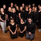 The Axminster Musical Theatre cast of Evita