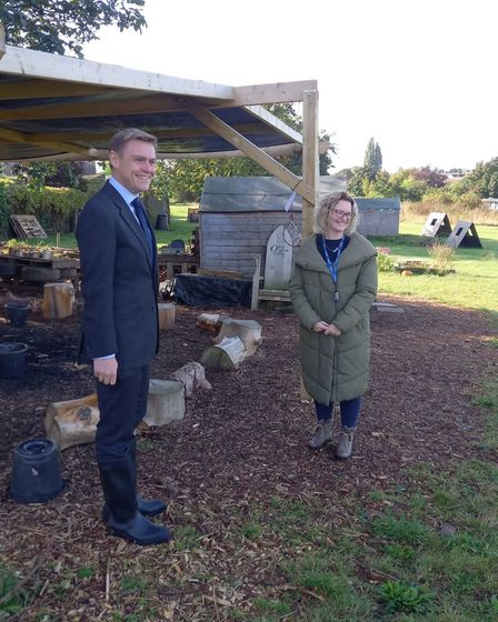 Will Quince pictured with headteacher of Castle Hill Primary School at the forest school