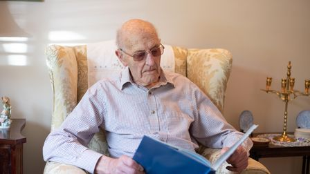 John Northfield, 94, looking at a book about the Port of Felixstowe, where he was chief engineer