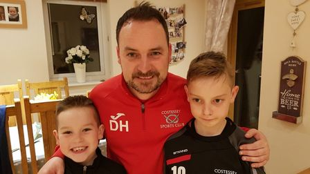 Dan Henry, volunteer coach of the Costessey Sports Club U9 Eagles team with his sons Elliot, nine (l
