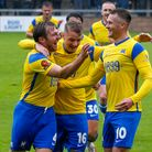 Goal celebrations for Torquay United's Tom Lapslie during the match between the Gulls and Wealdstone