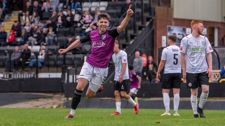 Alex Brown enjoys scoring Hitchin's second goal in the draw at Hednesford.