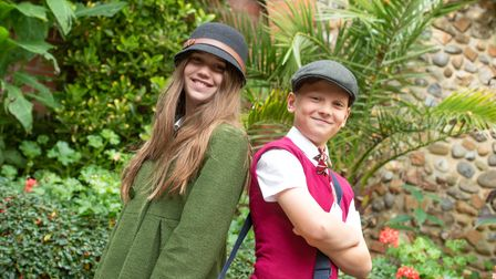 Two pupils from Stratford St Mary Primary School wearing wartime clothing