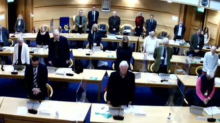 Councillors stand to remember Sarah Oxley at a London Road meeting