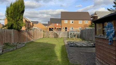 Beverley and John Sims' back garden is now overlooked by the new builds at Meridian Gate.