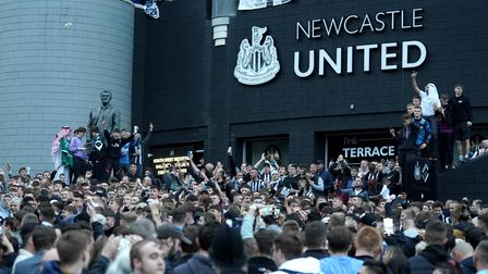 Newcastle United fans celebrate at St James' Park following the announcement that The Saudi-led take