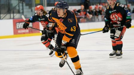 Raiders captain Aaron Connolly rushes the puck forward against Telford Tigers