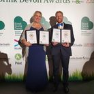 John Hammond and Kirsty Hammond from Sidmouth Gin with their awards