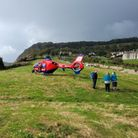 A woman was flown to hospital by Devon Air Ambulance after fallingat Jacob's Ladder