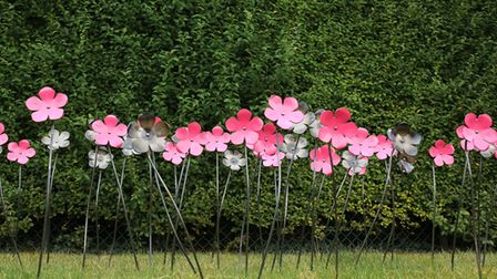 Pink and grey metal Blooms for Blossom flowers on display