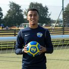Tevan Allen holding a football fun factory football on a pitch