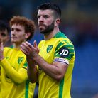 Dimitris Giannoulis of Norwich, Josh Sargent of Norwich and Grant Hanley of Norwich at the end of th