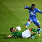 Peterborough United's Siriki Dembele is tackled by Brighton and Hove Albion U21's Mathias Normann du