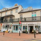 Sidmouth seafront businesses the Mocha restaurant, Toto's shop, ice cream parlour and fish and chip shop