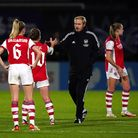 Arsenal head coach Jonas Eidevall greets Kim Little after the final whistle during the Women's UEFA