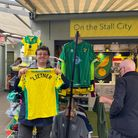 Jacob Bowles holding up the Moritz 'Lietner' shirt being sold for £2 at On the Stall City