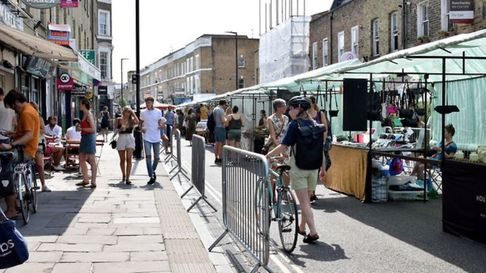 Broadway market is brimming with vistors browsing the Saturday stalls-