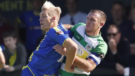 Yeovil Town's Lee Collins with Solihull Moors player Danny Wright. Photo: Steve Bond/PPAUK