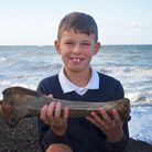 Callum Hoare with the giant bone that he found on Sheringham beach. Pictures: Brittany Woodman