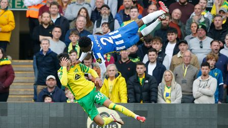 Tariq Lamptey of Brighton & Hove Albion and Dimitris Giannoulis of Norwich clash during the Premier