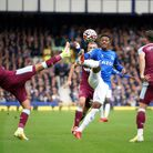 Everton's Demarai Gray (centre) and West Ham United's Pablo Fornals (left) battle for the ball durin