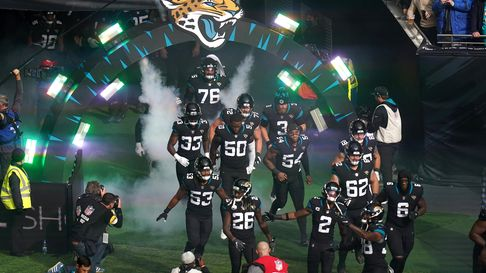 Jacksonville Jaguars team walk out ahead of the match which is part of the NFL London Games at Totte