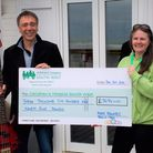 Mark Edwards presents his fundraising cheque to CHSW area fundraiser Ruth Morgan