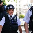 Metropolitan Police Commissioner Dame Cressida Dick alongside police officers during a walkabout in