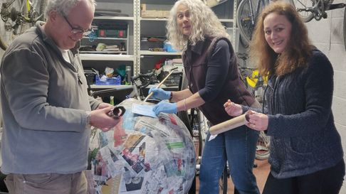 Richard Lafford, Jo Pritchard and Clare Miles from St Albans Friends of the Earth creating the 'burning globe' sculpture.