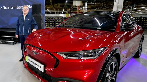 Stuart Rowley president, Ford of Europe with a Mustang Mach-E at their car manufacturing plant in Ha