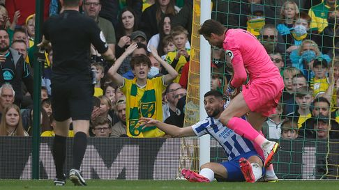 Tim Krul of Norwich is not impressed with the playacting of Neal Maupay of Brighton & Hove Albion du
