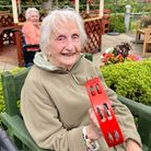 A Mountfitchet House resident, Olive, with a tambourine