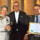 Lynette Talbot and Peter Endersby from Sidmouth In Bloom with garden designer James Alexander-Sinclair, centre