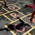 Children at St. George's C of E Primary School in Stockport,play hop scotch during playtime.